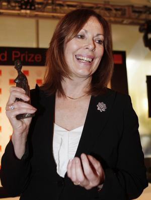 "Author Rose Tremain poses with her award for her novel ""The Road Home"" after winning the Orange Prize for Fiction"